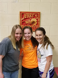 Taylor Mullins (pictured in middle) with her mother Cassie and sister Ashton, a former great slap hitter