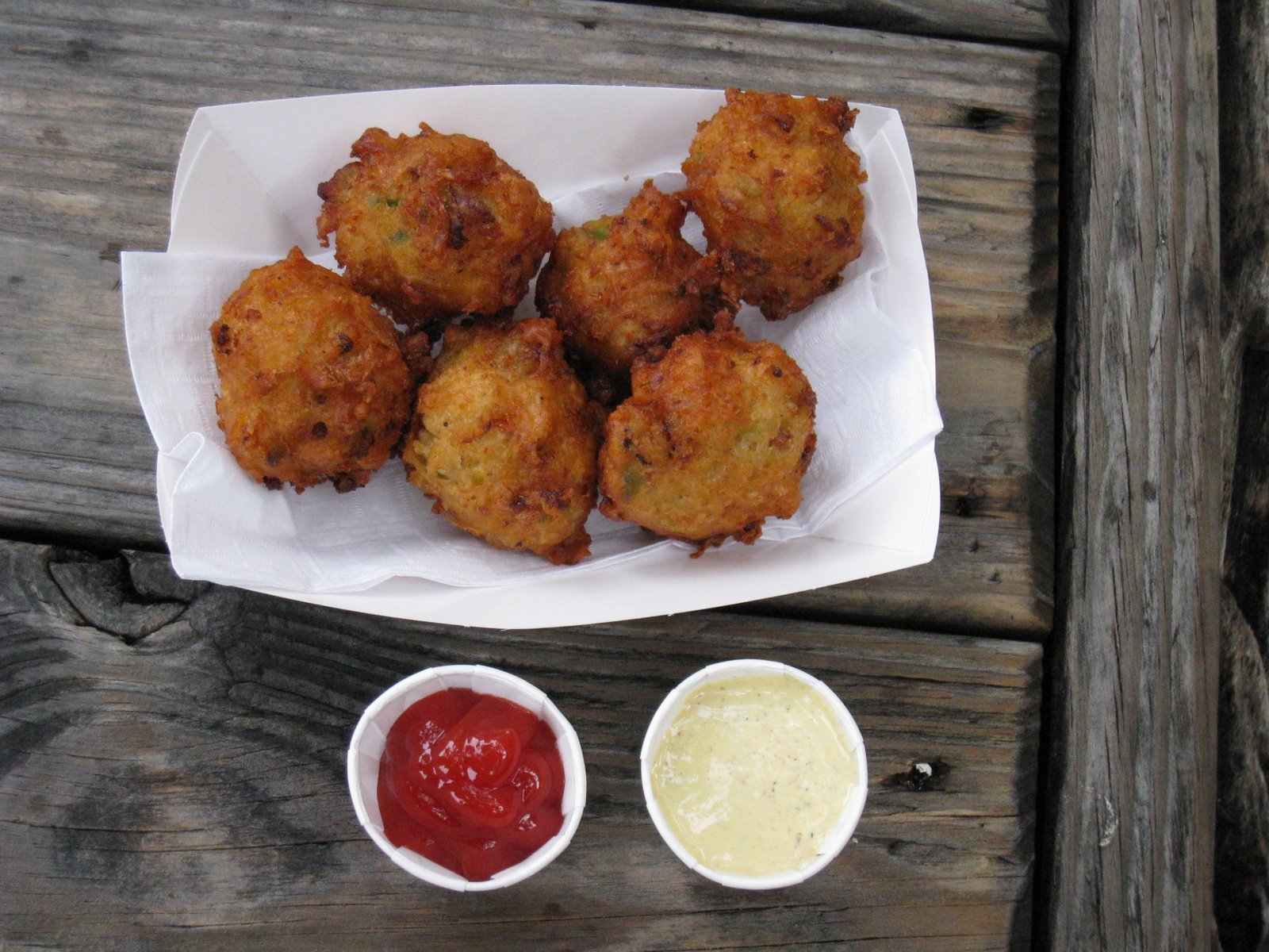 """Conch Fritters with ketchup and """"Key Lime Mustard"""" - whatever the hell that is. Tasted like plain ol' mustard to me!"""