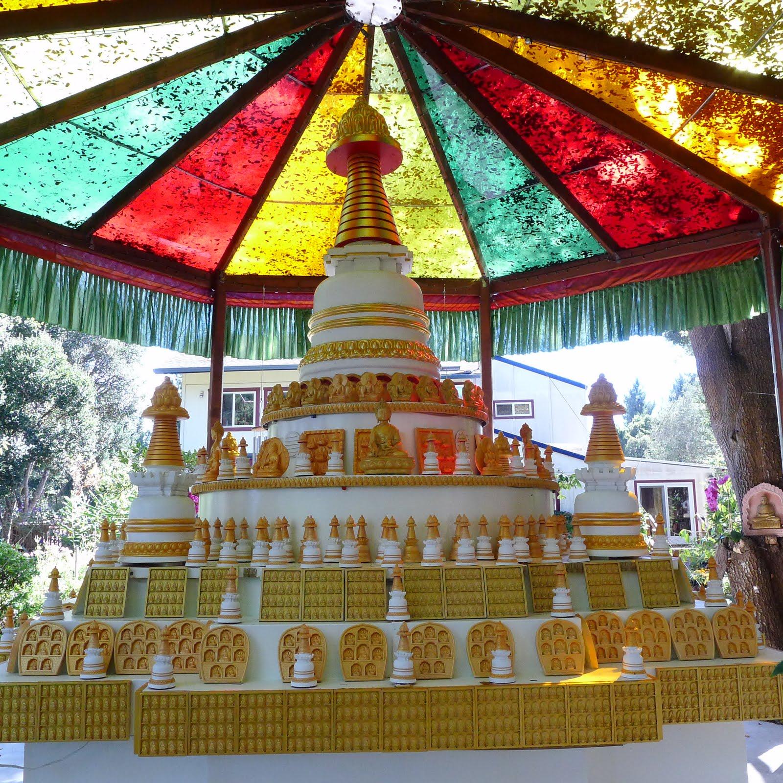 Kadampa stupa with many other stupas and tsa tsas at Kachoe Dechen Ling, Aptos, CA, USA.