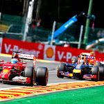 Fernando Alonso in his Ferrari F14T still leads Daniel Ricciardo's Red Bull