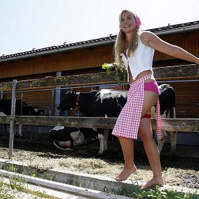 Young Bavarian farm woman Julia-Christin poses during a photo shoot for a calendar of German and Austrian farmer wives in Altenstadt near Munich June 20, 2007. 'The German Girls edition 2008' is a homage to all young farmer's wives in Germany and Austria working in the agricultural industry.  REUTERS/Michael Dalder    (GERMANY)
