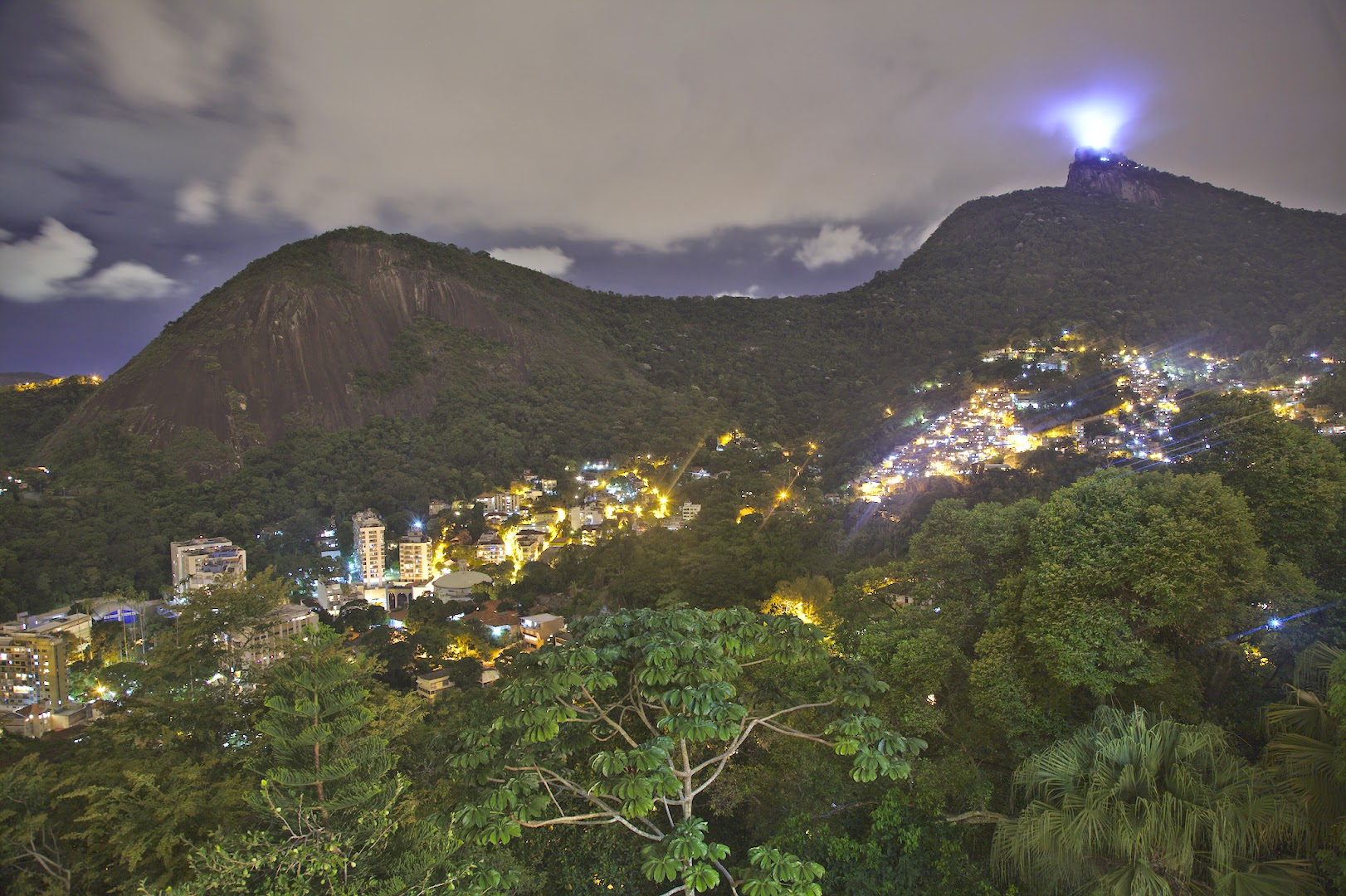 View from a terrace in Santa Teresa during the night. Bright spot is the Cristo Redentor