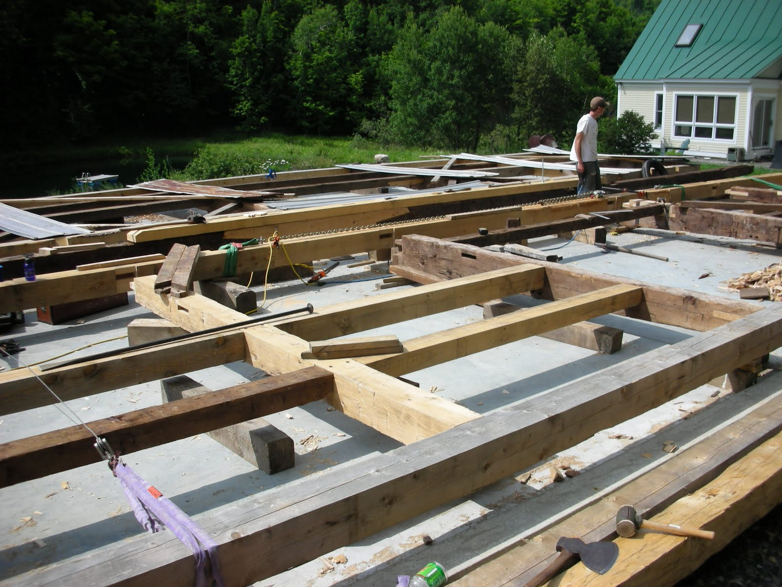 The eave walls are being assembled before the raising.