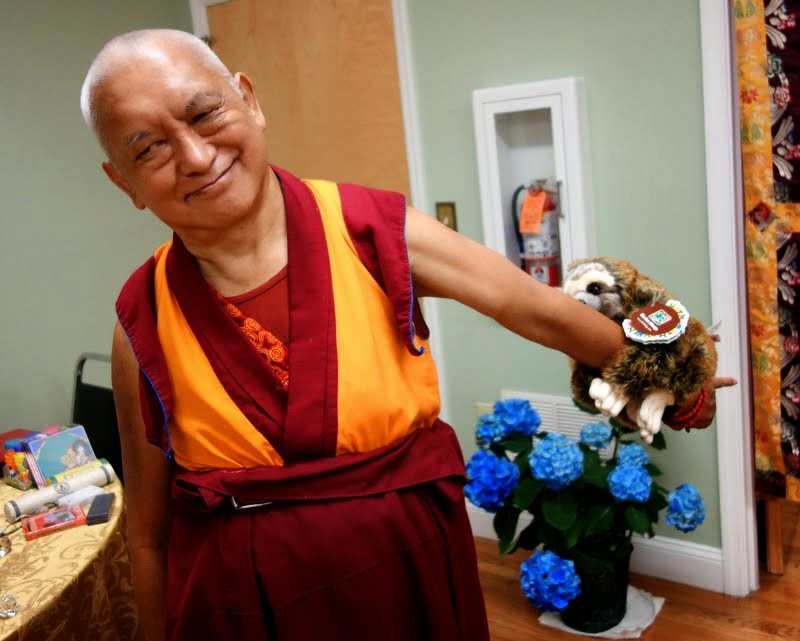 Lama Zopa Rinpoche with a new friend, Black Mountain, North Carolina, US, May 2014. Photo by Ven. Roger Kunsang.