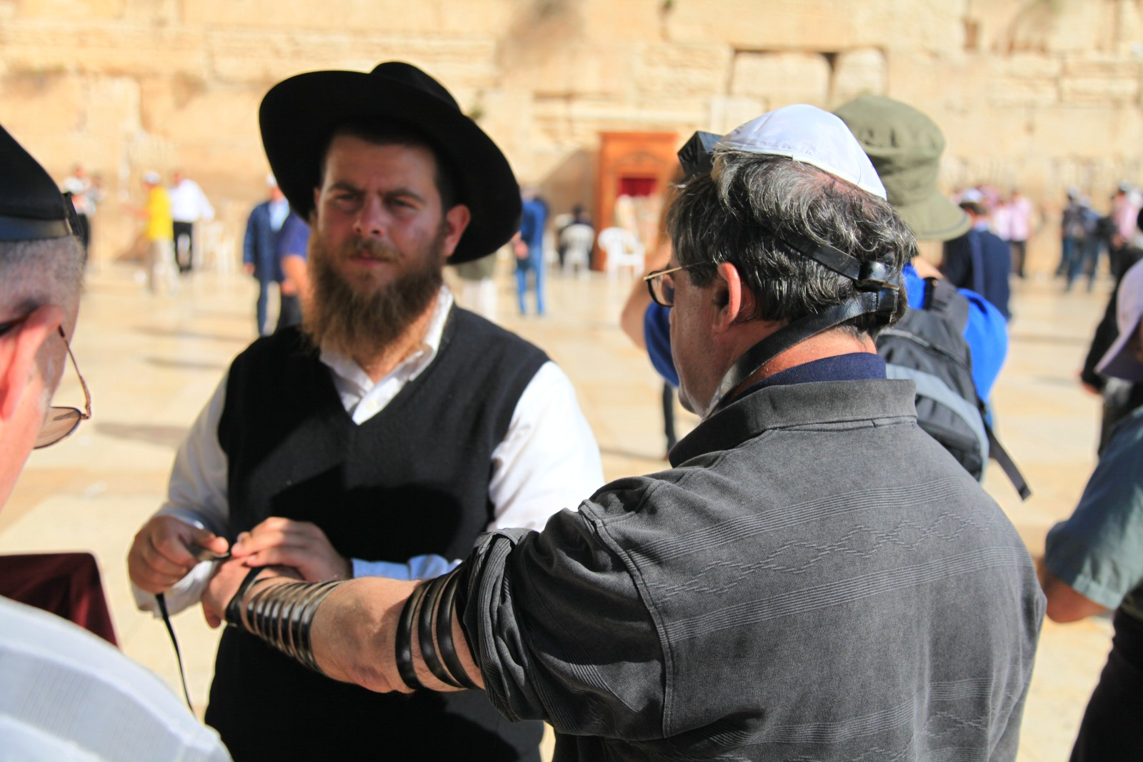 The guy failed to explain me what is the meaning of it, even though he spoke fluent Russian - it just something that foreign Jews like to wear for prayer. And they pay for wearing this.