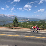 Beautiful mountains and green valley, some Eyecycle riders on the Triple Bypass