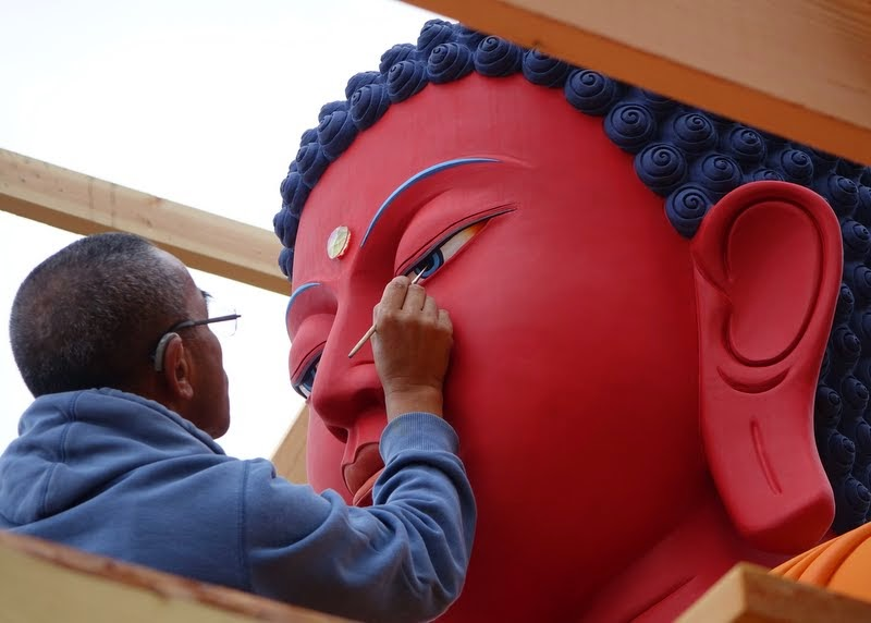 Artist Gelek Sherpa opening the buddha statue's eyes the day before the celebration at Buddha Amitabha Pure Land, Washington, US, August 2014. Photo by Ven. Roger Kunsang.