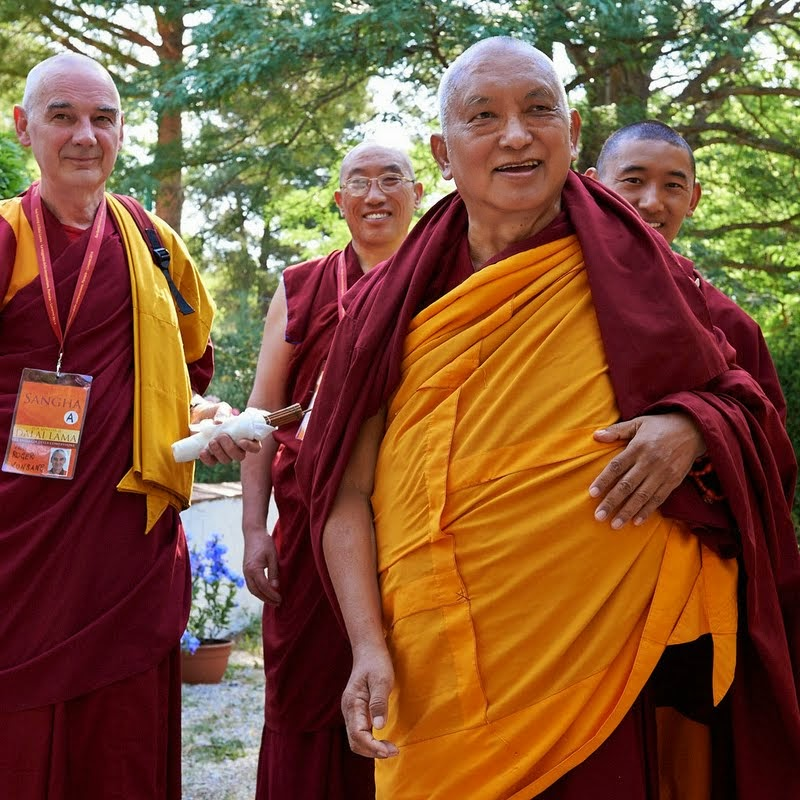 Lama Zopa Rinpoche with (from left) Ven. Roger Kunsang, assistant to Rinpoche and CEO of FPMT; Geshe Jampa Gelek, resident geshe at Istituto Lama Tzong Khapa (ILTK); and Ven. Sangpo, Rinpoche's attendant, going to hear His Holiness the Dalai Lama at Istituto Lama Tzong Khapa, Italy, June 13, 2014. Photo by Olivier Adam.