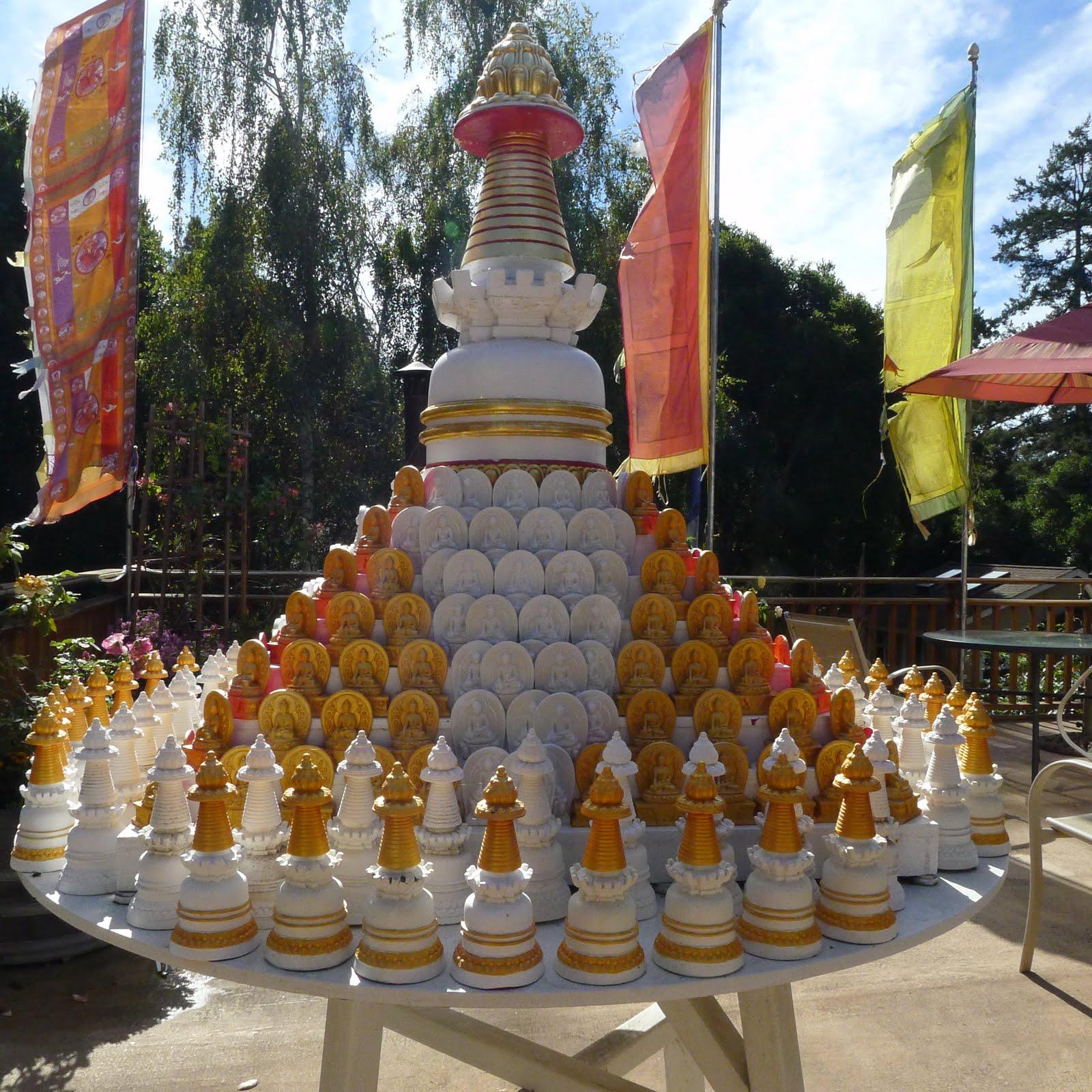 Table with many small Kadampa stupas to circumambulate Kachoe Dechen Ling,  Aptos, CA, USA.