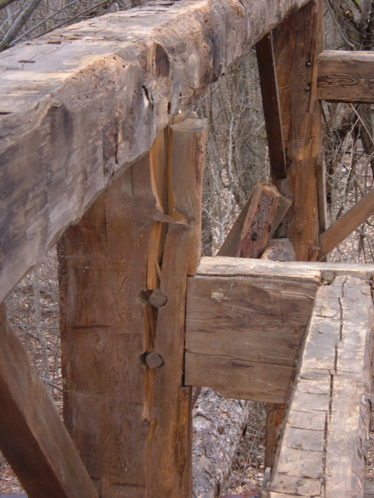 Outward thrust of the rafters on the plates split the tops of four of the posts at the tie beam.