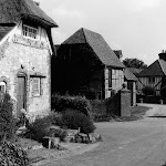 Owlscote Manor Farm from High Street. Sign of the Crown on left.