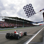 Jenson Button, Honda RA106 takes the chequered flag to win his first GP