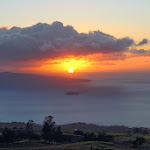 Maui sunset from somewhere on the road from Hana near Tedeschi winery: the small crescent-shaped island in the foreground is the extinct volcanic crater of Molokini