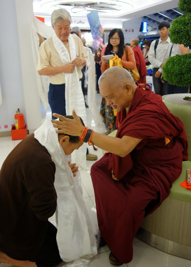 Lama Zopa Rinpoche being greeted by students upon his arrival in Taipei, Taiwan, March 2014. Photo by Ven. Thubten Kunsang.
