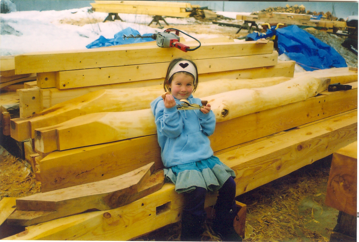 The log joists behind Seth's daughter are yellow birch and were adzed out.