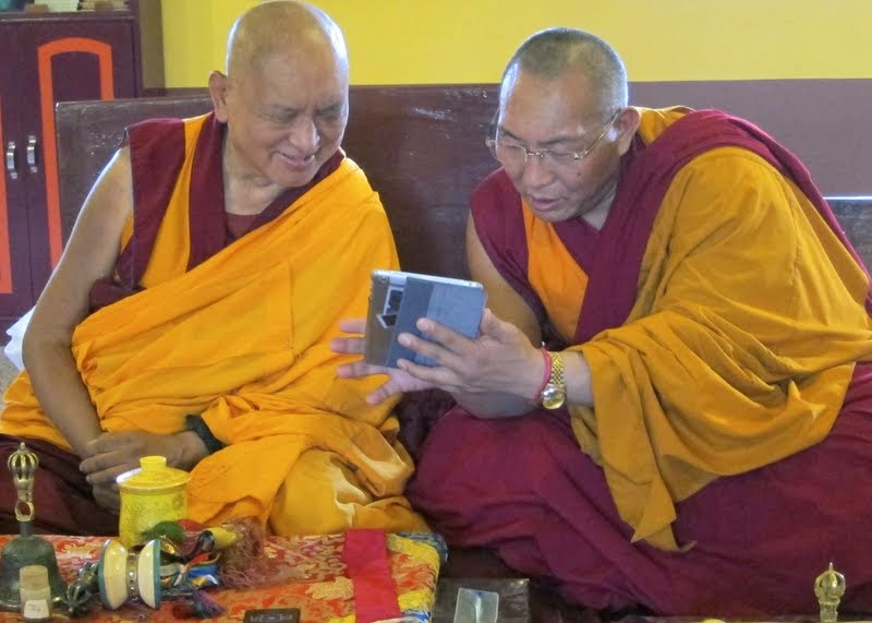 Lama Zopa Rinpoche and Dagri Rinpoche doing puja at Root Institute, Bodhgaya, India, February 2014. Photo by Ven. Sarah Thresher.