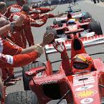 Michael Schumacher high five after winning the 2006 USA F1 GP