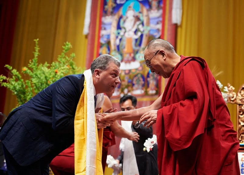 His Holiness with Filippo Scianna, director of Istituto Lama Tzong Khapa, at conclusion of teachings, Livorno, Italy, June 15, 2014. Photo by Olivier Adam.