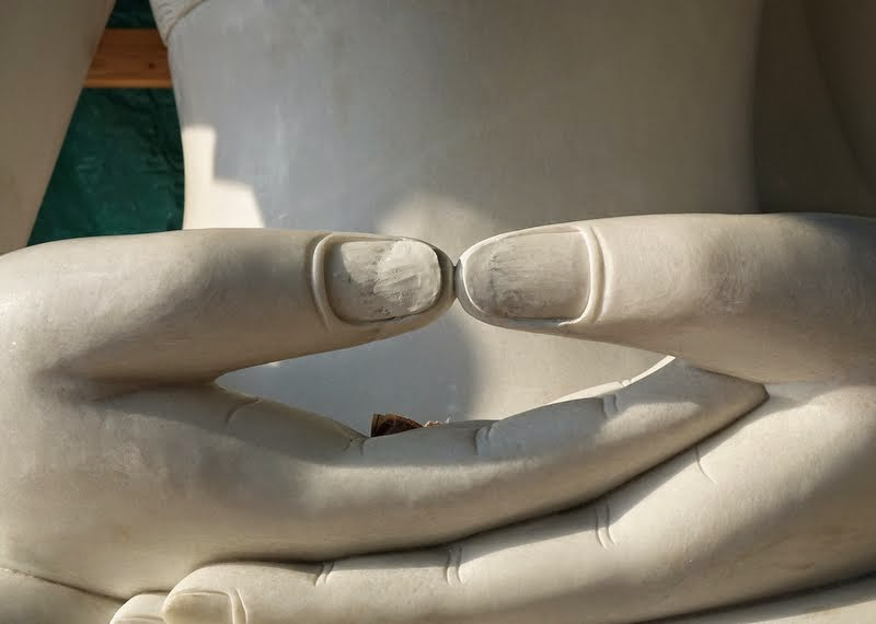 The thumbs of the statue also need to be extended to touch, Buddha Amitabha Pure Land, Washington, US, August 2014. Photo by Ven. Roger Kunsang.