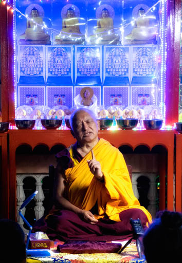 Lama Zopa Rinpoche teaching outside on the roof at Root Institute, India, March 2015. Photo by Andy Melnic.