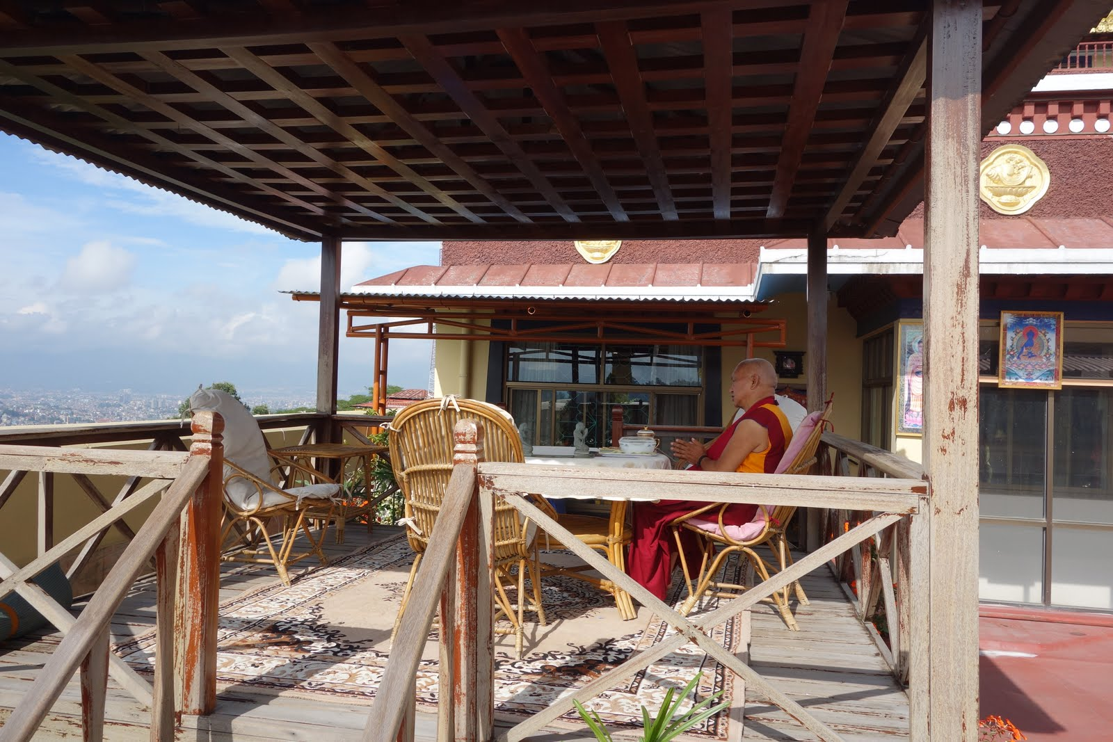 Rinpoche doing prayers before breakfast, with a view of the Kathmandu valley (from Kopan ). Aug 10, 2013. Photo by:Ven. Photo Roger Kunsang.