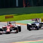 Kimi Raikkonen, Ferrari F14T passes Vergne