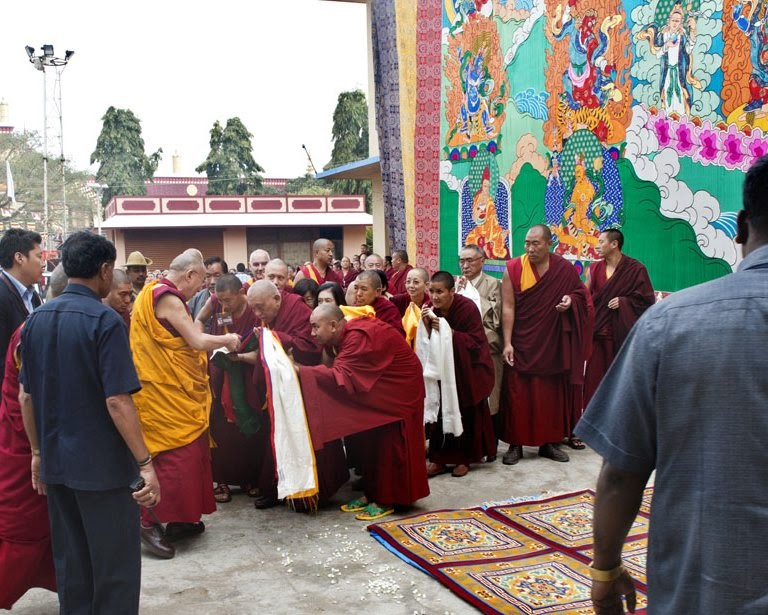 His Holiness the Dalai Lama with Lama Zopa Rinpoche and the giant Guru Rinpoche thangka, Sera Je Monastery, India, December 29, 2013. Photo copyright Rio Helmi/Jangchup Lamrim Teaching Organizing Committee.