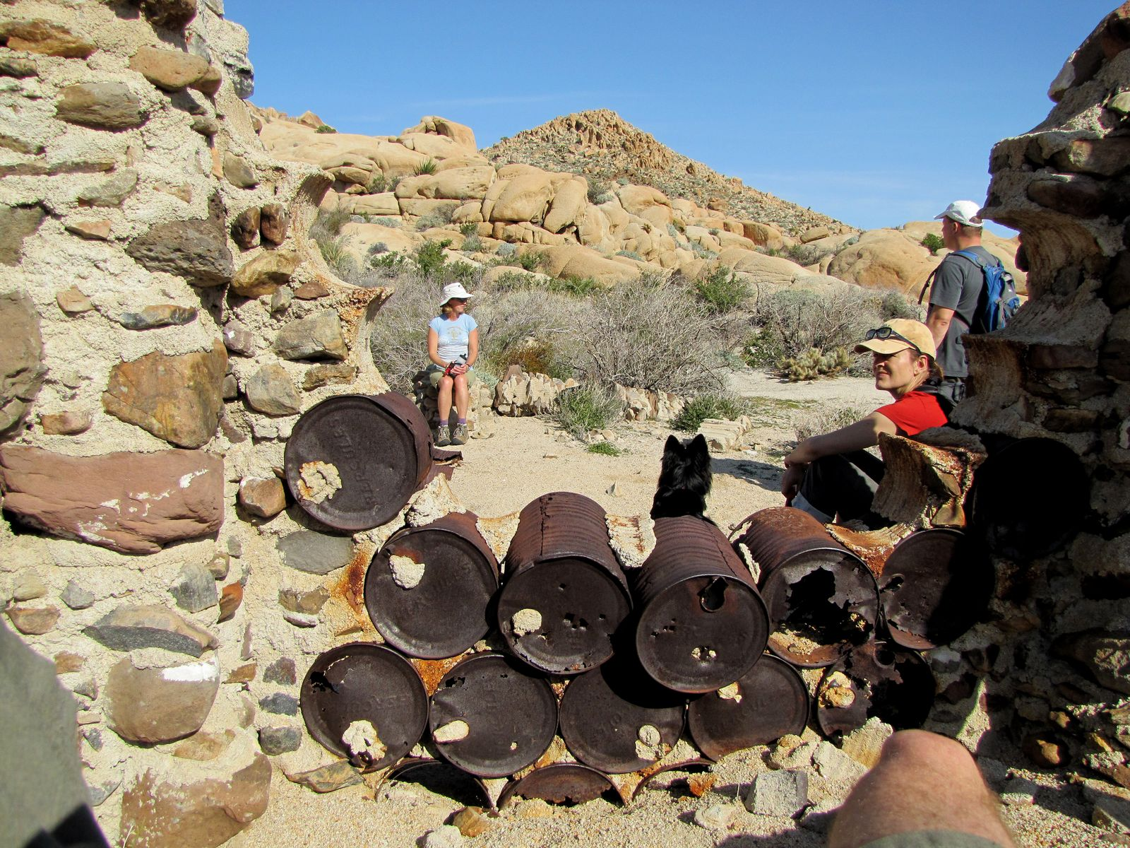 Ingenuity. The railroad camp was built using the old blasting powder cans stuck together with mortar