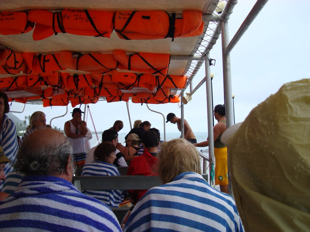Saturated tourists......As soon as we got on our boat we got saturated with some serious rain