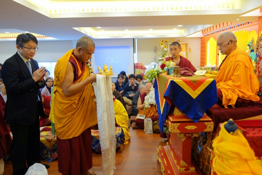 Geshe Gyurme, Jinsiu Farlin resident geshe, with Dr. Steve Lin, FPMT Taiwan national coordinator, offering mandala to Lama Zopa Rinpoche during the opening ceremony for the renovated center, Taipei, Taiwan, April 2014. Photo by Ven. Roger Kunsang.
