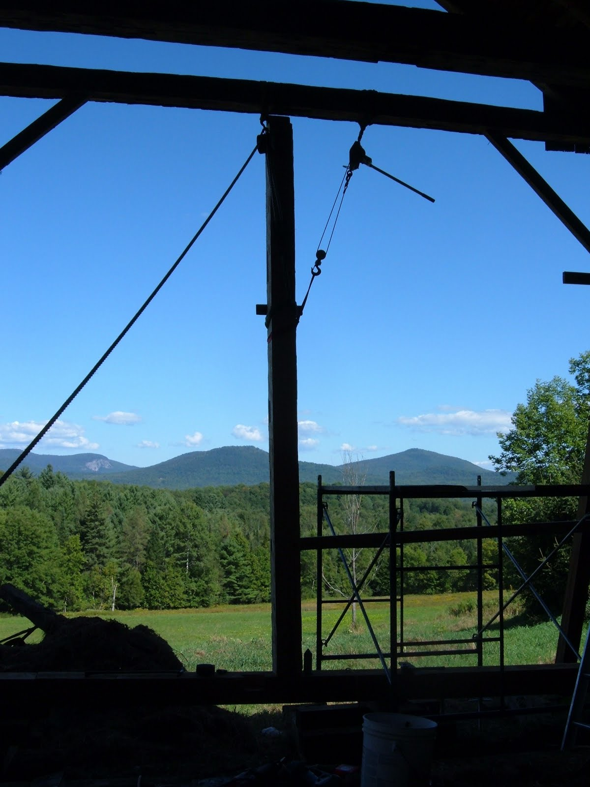 This is a view of the same gable wall as a new post is being lifted into place.