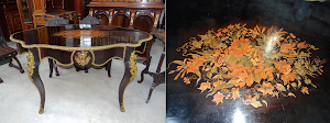 Красивый антикварный стол с цветочным узором. 19-й век. Чёрный лак, позолоченная бронза, маркетри с цветочным узором. 145/90/80 см. 3300 евро.