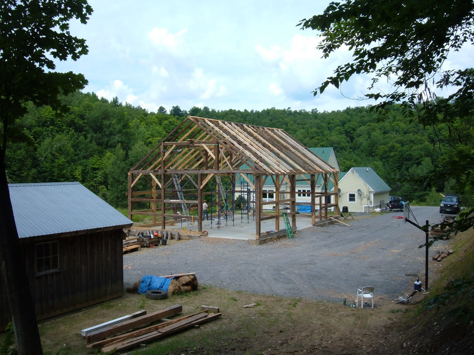 The frame assembly nears completion.  Only the interior posts and second floor system are missing in this photo.