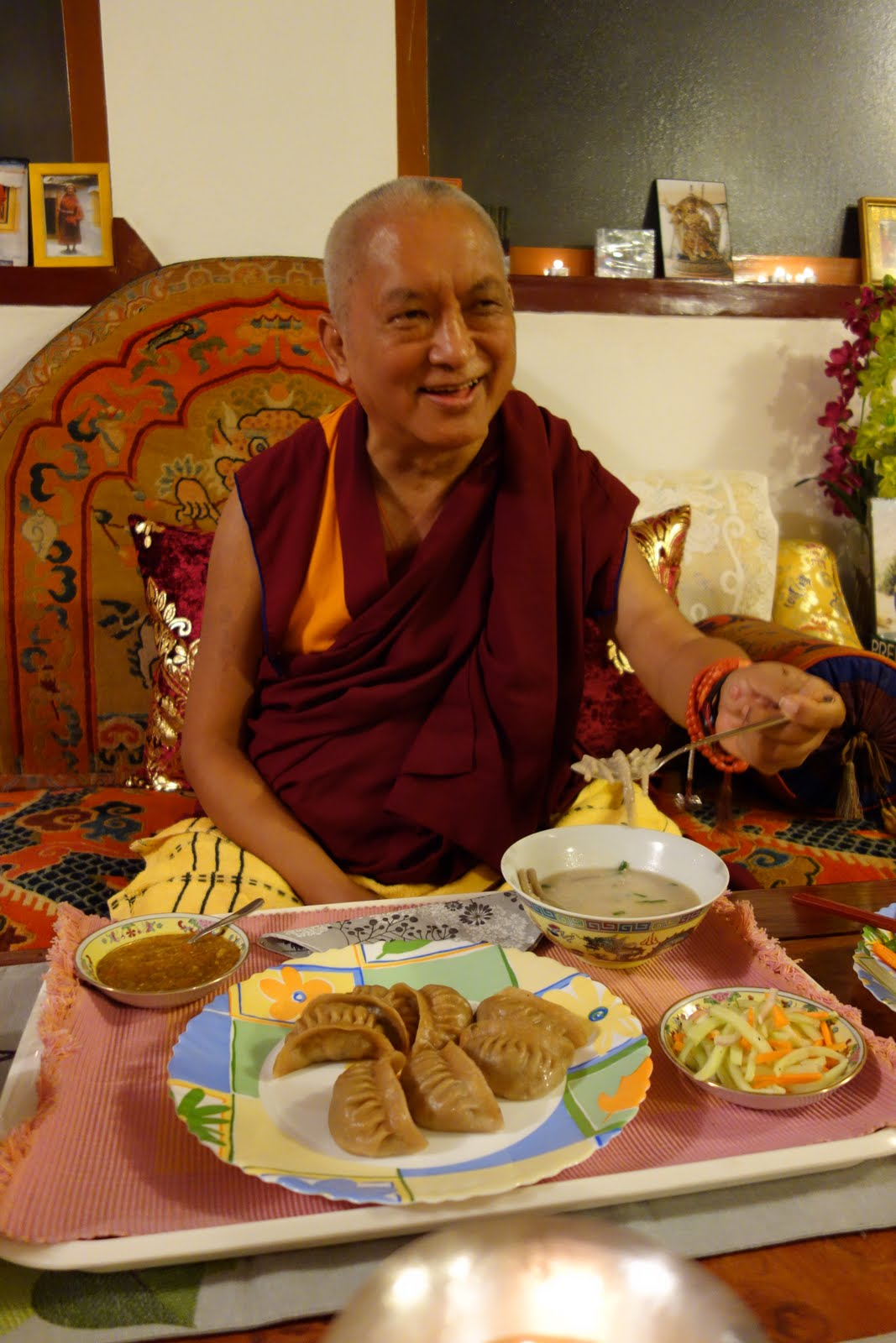 """Rinpoche having dinner at his brother, Sangay's, eating for the first time since he was a child before leaving for Tibet the food called """"thor."""" It is made from a wild flower that grows in the mountains and has deep roots . Rinpoche enjoyed very much."""