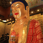 More buddhas, a big one and thousands of small ones...