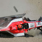 Christijan Albers crashes hard with the Midland M16