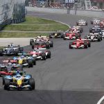 Fernando Alonso, Renault R26 leads Kimi Raikkonen, McLaren MP4-21 Mercedes and Giancarlo Fisichella, Renault R26 at the start of the race.