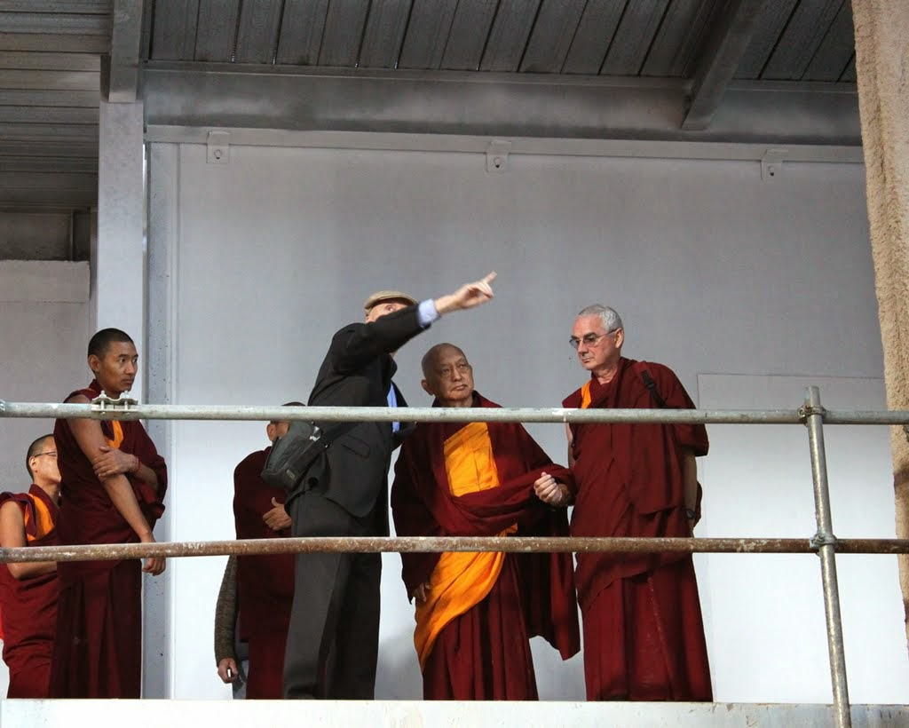 Ian Green, director of Great Stupa of Universal Compassion, offering Rinpoche a tour of the Great Stupa whose structure is nearing completion, Australia, September 2014. Photo by Ven. Thubten Kunsang.