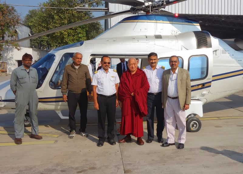 Lama Zopa Rinpoche before flying in a helicopter to Kushinagar for Maitreya Project ceremony, India, December 13, 2013. Photo by Ven. Roger Kunsang.