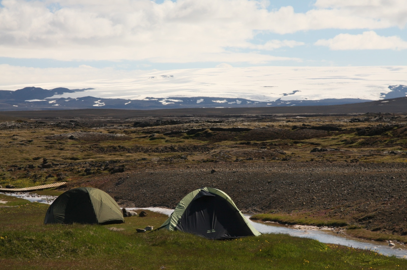 Camping with a view to glaciers, on the shore of hot spring, which doesn't help the cold air during the night