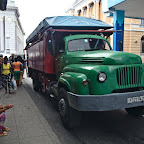 People bording a camion - public truck transport