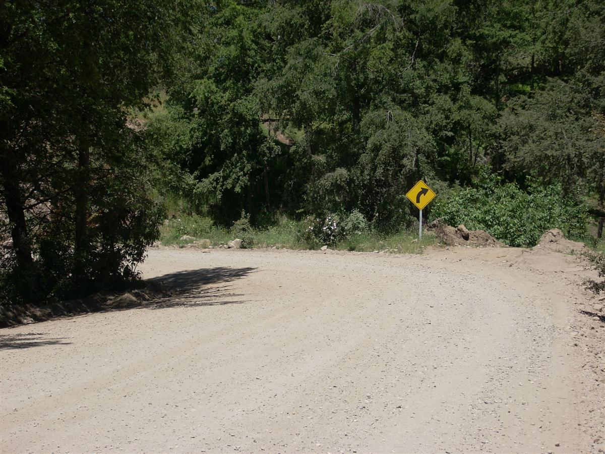 Note the sign pointing right, but the road going left