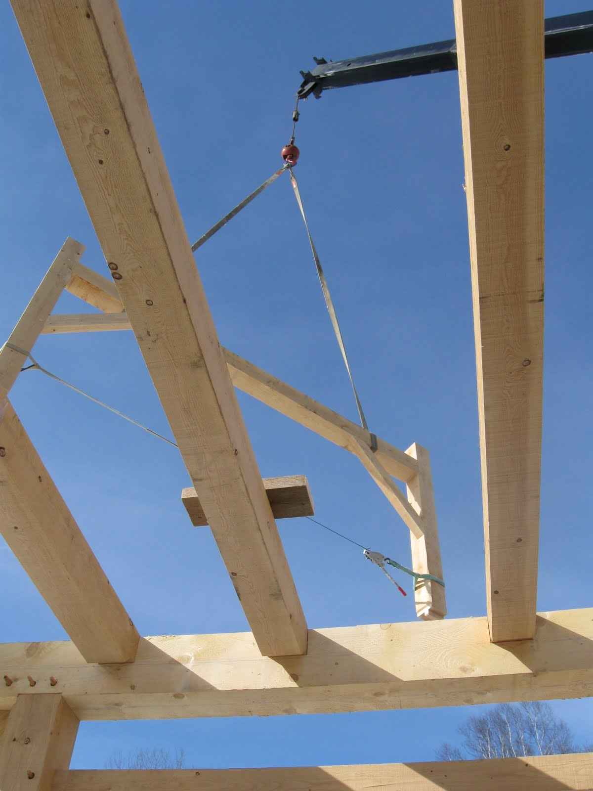 The gable bent of the purlinn system is flown into place.