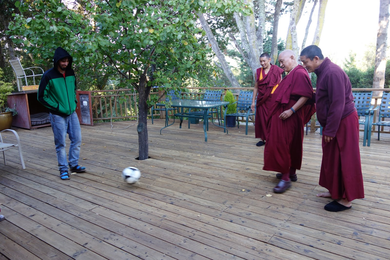 Tenzin Osel helping Rinpoche with his soccer exercise.