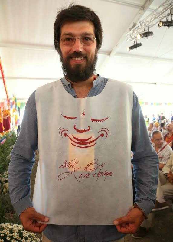 Staff for the events with His Holiness the Dalai Lama wore vests printed with a smiling face drawn by Lama Zopa Rinpoche, Italy, June 13, 2014. Photo by Ven. Thubten Kunsang.