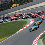Fernando Alonso, Renault R26 and Giancarlo Fisichella, Renault R26 lead the field away at the start
