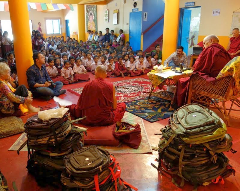 Lama Zopa Rinpoche giving a talk to students, staff and parents at Maitreya School at Root Institute, Bodhgaya, India, March 2014. Photo by Ven. Roger Kunsang.