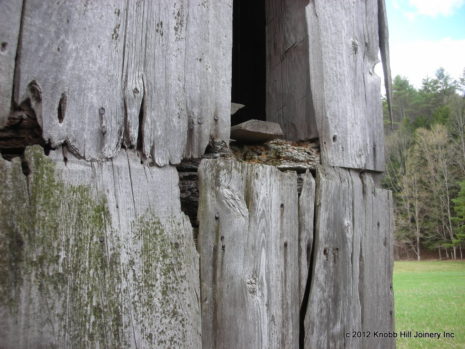 The ends of the vertical sheathing boards were splayed and lapped over one another.  The visible rot to the middle girt only hinted at the extent of the damage.