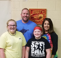 Karlie Fraley (10 years old and a pitcher) with her parents Brad & Andrea and her sister Kacie from Bolt, WV