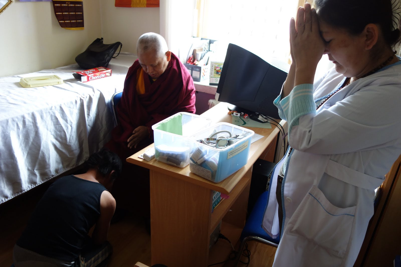 After this woman heard that Rinpoche was the main reason FPMT Mongolia's free soup kitchen and health clinic in Ulaanbaatar, Mongolia she immediately prostrated before Rinpoche thanking him because she only managed to stay alive due this help. September 2013. Photo by Ven. Roger Kunsang.